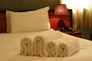 Кровать или кровати в номере Byblos Comfort Hotel