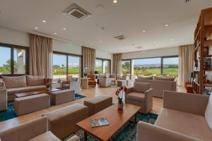 A seating area at Aphrodite Hills Golf & Spa Resort Residences – Apartments