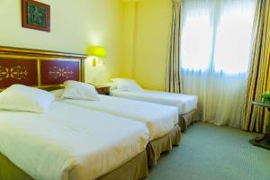 A bed or beds in a room at Velada Mérida