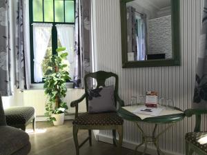 Ein Sitzbereich in der Unterkunft Hotel Villa Alice