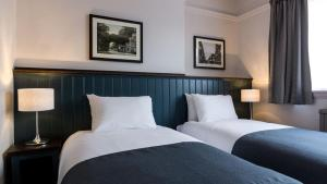 A bed or beds in a room at Southern Cross