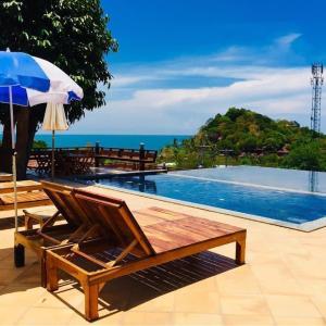 The swimming pool at or near Phuchawee Lanta