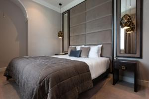 A bed or beds in a room at Brandon Hall Hotel & Spa Warwickshire