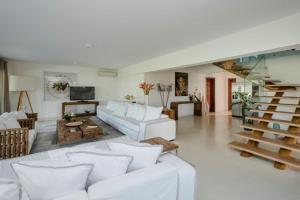 Uma área de estar em Campo Bahia Hotel Villas Spa