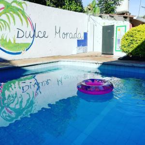The swimming pool at or near Dulce Morada Hostal