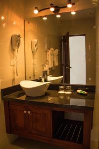 Salle de bains dans l'établissement Hotel Villa Taina