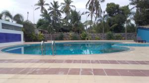 The swimming pool at or near Orchid Resorts ECR