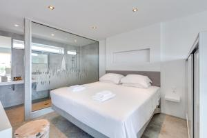 A bed or beds in a room at Chania Urban Living