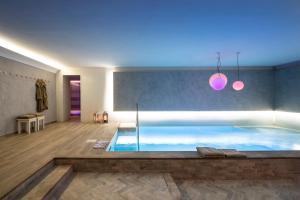 The swimming pool at or near Altarocca Wine Resort