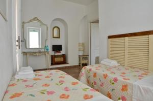 A bed or beds in a room at Casale Del Gelso