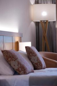 Un ou plusieurs lits dans un hébergement de l'établissement Monte Mar Palace Hotel