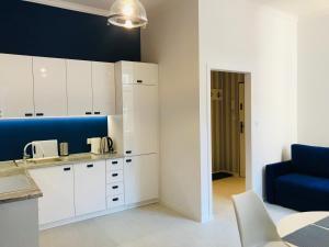 Kuchnia lub aneks kuchenny w obiekcie Apartament Pod Żaglami