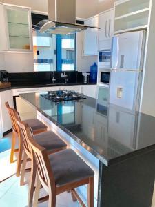 A kitchen or kitchenette at Lindo AP MP Vista Total Mar