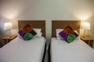 A bed or beds in a room at Albert Heights Serviced Apartments