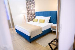 A bed or beds in a room at Megapolis Luxury Suites