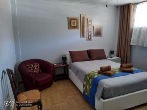 Cama ou camas em um quarto em soleil de Pirae