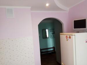 Кухня или мини-кухня в Apartment on Lenina 128