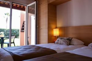 Un ou plusieurs lits dans un hébergement de l'établissement Hôtel Club L'Oustal Del Mar
