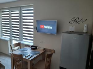 Телевизия и/или развлекателен център в Apartment RELAX
