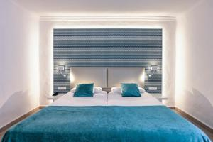 A bed or beds in a room at Aldiana Club Fuerteventura