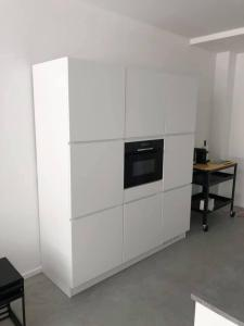A kitchen or kitchenette at Huize Hoge Fronten
