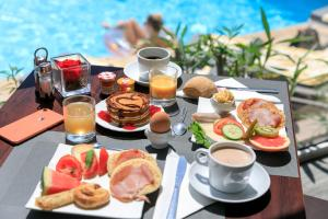 Breakfast options available to guests at The Originals Boutique, Hôtel des Orangers, Cannes (Inter-Hotel)