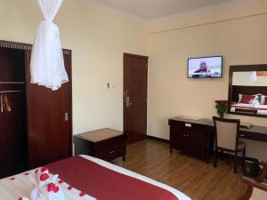 A bed or beds in a room at Delano Hotel & Spa, Bahir Dar