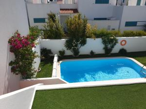 The swimming pool at or near L&A Villa with Private Pool in Prainha
