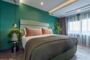 A bed or beds in a room at Bliss Hotel Southport
