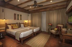 A bed or beds in a room at Nepali Ghar Hotel