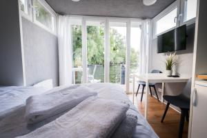 Ein Bett oder Betten in einem Zimmer der Unterkunft Das kleine Hausboot am Wannsee