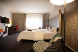 A bed or beds in a room at pentahotel Kassel