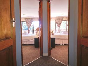A bed or beds in a room at Elephant Lake Hotel