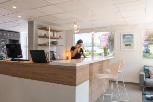 The lobby or reception area at Kyriad Montpellier Ouest St Jean de Védas - A709