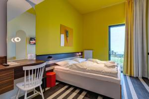 A bed or beds in a room at MEININGER Hotel Bruxelles Gare du Midi