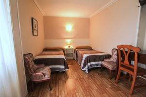 A bed or beds in a room at Pensión San Jorge