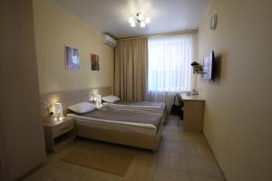 Кровать или кровати в номере Отель Московский