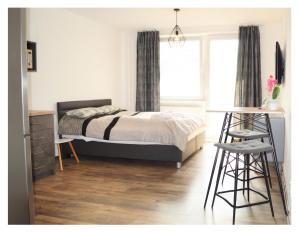 Posteľ alebo postele v izbe v ubytovaní SGL apartments Lavickova