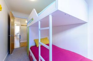 A bunk bed or bunk beds in a room at Beach Retreat Broadstairs