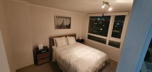 Cama o camas de una habitación en Hermoso Departamento Con Vista Al Mar