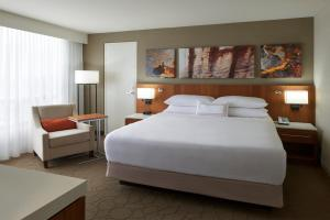 A bed or beds in a room at Delta Hotels by Marriott Toronto Airport & Conference Centre