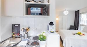 A kitchen or kitchenette at Relax Aachener Board Appartements Phase 4