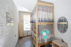 A bunk bed or bunk beds in a room at Островок Матиса