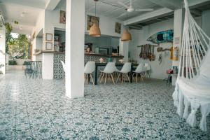 Een restaurant of ander eetgelegenheid bij Casa del Pavo Real Boutique Hostel