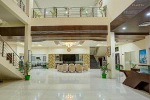 The lobby or reception area at Hotel Amrit Manthan
