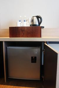 Coffee and tea-making facilities at Jinhold Hotel & Serviced Apartment