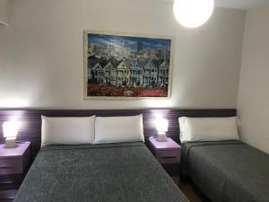 Cama o camas de una habitación en Pension Berceo