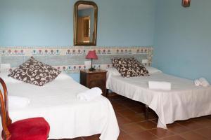 Cama o camas de una habitación en Cortijo Torreblanca