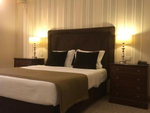 A bed or beds in a room at Hotel Grao Vasco