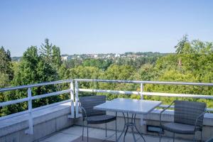 A balcony or terrace at Vichy Celestins Spa Hotel